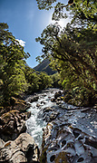 The Chasm was carved by Cleddau River in Fiordland National Park, Southland region, South Island of New Zealand. In 1990, UNESCO honored Te Wahipounamu - South West New Zealand as a World Heritage Area. This image was stitched from multiple overlapping photos.