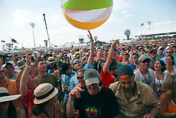 26 April 2014. New Orleans, Louisiana.<br /> beach balls dance above the crowds at the New Orleans Jazz and Heritage Festival. <br /> Photo; Charlie Varley/varleypix.com