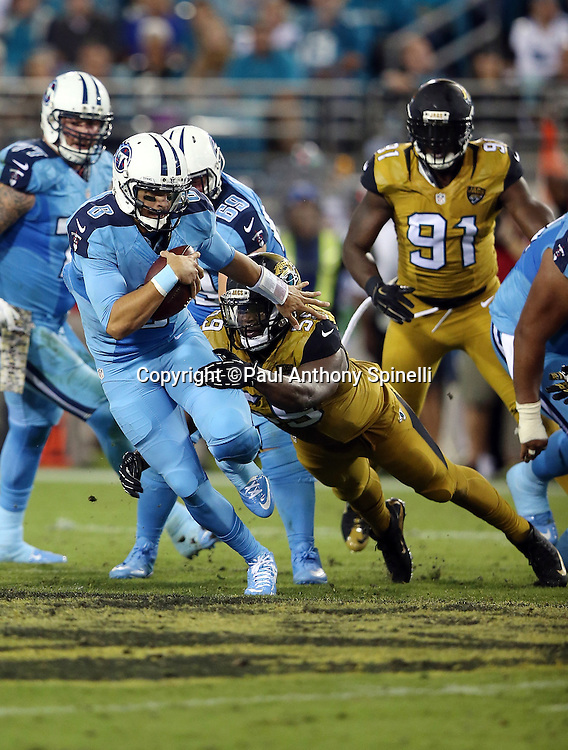 Tennessee Titans quarterback Marcus Mariota (8) gets sacked by Jacksonville Jaguars defensive end Ryan Davis (59) late in the second quarter during the 2015 week 11 regular season NFL football game against the Jacksonville Jaguars on Thursday, Nov. 19, 2015 in Jacksonville, Fla. The Jaguars won the game 19-13. (©Paul Anthony Spinelli)
