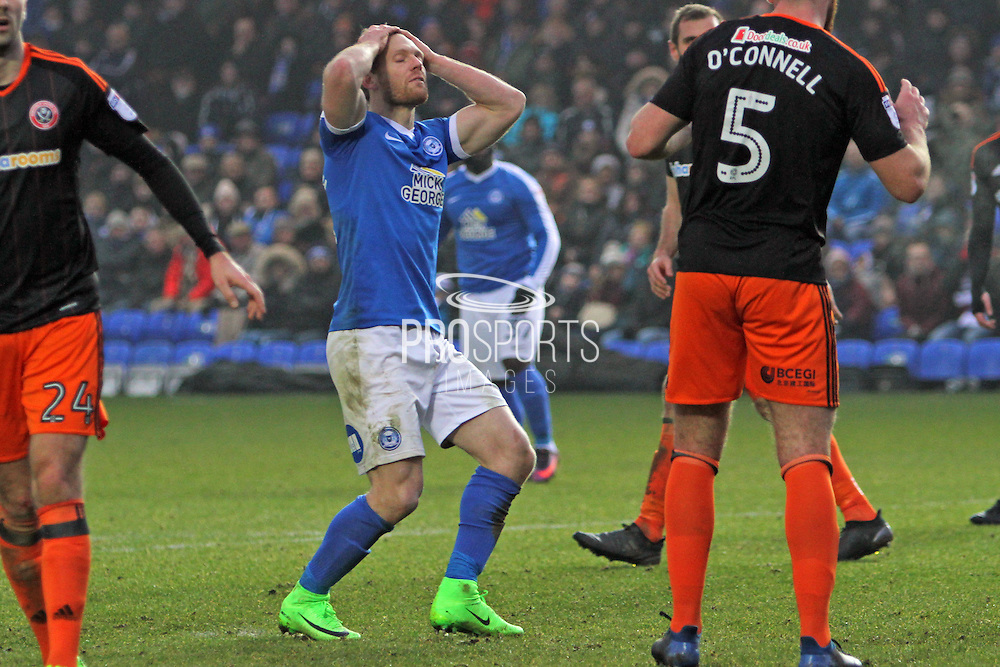 Peterborough United forward Craig Mackail-Smith (13) rues a missed chance during the EFL Sky Bet League 1 match between Peterborough United and Sheffield Utd at London Road, Peterborough, England on 11 February 2017. Photo by Nigel Cole.