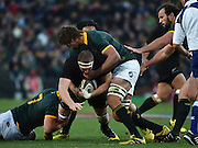 JOHANNESBURG, South Africa, 25 July 2015 : Brodie Retallick of the All Blacks is tackled by Francois Louw (7) and Eben Etzebeth of the Springboks during the Castle Lager Rugby Championship test match between SOUTH AFRICA and NEW ZEALAND at Emirates Airline Park in Johannesburg, South Africa on 25 July 2015. Bokke 20 - 27 All Blacks<br /> <br /> © Anton de Villiers / SASPA