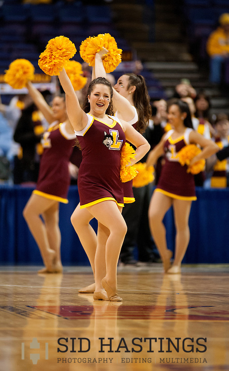 3 MARCH 2016 -- ST. LOUIS -- Cheerleaders from Loyola University Chicago cheer for LUC's men's basketball team during the Ramblers' game with Bradley University during the 2016 Missouri Valley Conference Arch Madness men's basketball tournament at the Scottrade Center in St. Louis Thursday, March 3, 2016. The Ramblers topped Bradley 74-66, to advance to the second round of the tournament.<br /> <br /> Photo &copy; copyright 2016 Sid Hastings.
