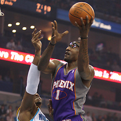 Feb 01, 2010; New Orleans, LA, USA; Phoenix Suns forward Amare Stoudemire (1) shoots over New Orleans Hornets forward David West (30) during the first half at the New Orleans Arena. Mandatory Credit: Derick E. Hingle-US PRESSWIRE