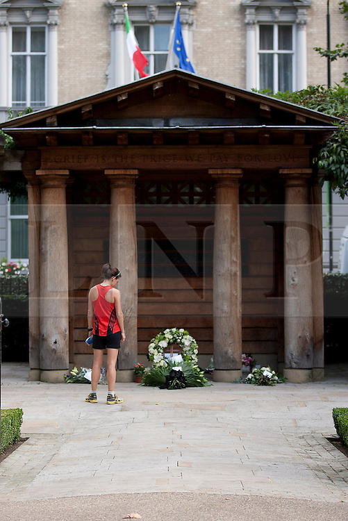 © Licensed to London News Pictures. 11/09/2012. LONDON, UK. A female runner pauses at the 9/11 memorial in Grosvenor Square, London,  today (11/09/12) on the 11th anniversary of the terrorist attack on the Word Trade Centre in New York. Photo credit: Matt Cetti-Roberts/LNP