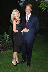 ROBERT HERSOV and DR KATIE JAMES at the annual Cartier Chelsea Flower Show dinner held at the Chelsea Physic Garden on 21st May 2007.<br />