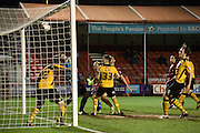 All eyes watch as Scott Boden's header loops over Joe Day into his own net during the Sky Bet League 2 match between Crawley Town and Newport County at the Checkatrade.com Stadium, Crawley, England on 1 March 2016. Photo by Michael Hulf.