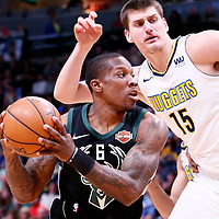 01 April 2018: Milwaukee Bucks guard Eric Bledsoe (6) drives past Denver Nuggets center Nikola Jokic (15) during the Denver Nuggets 128-125 victory over the Milwaukee Bucks, at the Pepsi Center, Denver, Colorado, USA.