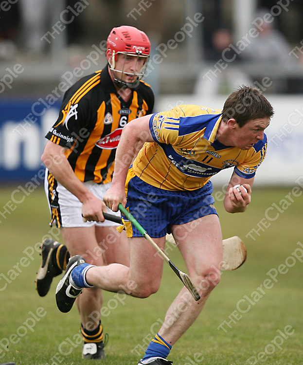 Clare's Diarmuid McMahon manages to stay ahead of Kilkenny's John Tennyson during their National Hurling League clash in Cusack Park on Sunday.<br /> Photograph by Yvonne Vaughan