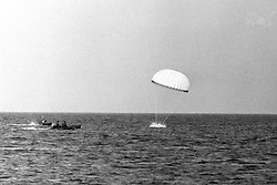 Parachuting Prince Charles splashes down into the English Channel, as a dinghy and assault boat stand by to pick him up from Poole Harbour.