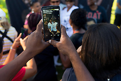 Stewart Carew of Trinidad, center, has his photo taken with well wishers before the funeral procession for boxing legend Muhammad Ali, a Louisville native, processed throughout Louisville including a stop by his childhood home on Grand Avenue, Friday, June 10, 2016 at Muhammad Ali Funeral Procession in Louisville.