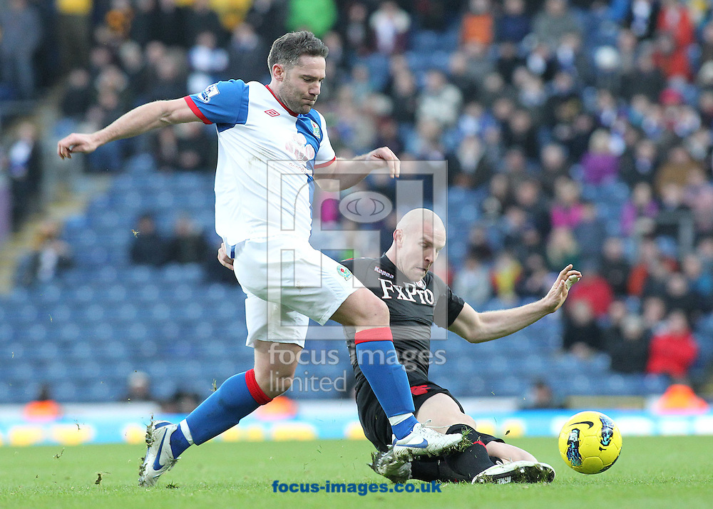 Picture by MIchael Sedgwick/Focus Images Ltd. 07900 363072.14/01/12.David Dunn of Blackburn and Philippe Senderos of Fulham in action during the Barclays Premier League match at the Ewood Park stadium, Blackburn, Lancashire.