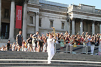 LONDON - JULY 26: Olympic Torch Relay, Trafalgar Square, London, UK. July 26, 2012. (Photo by piQtured)