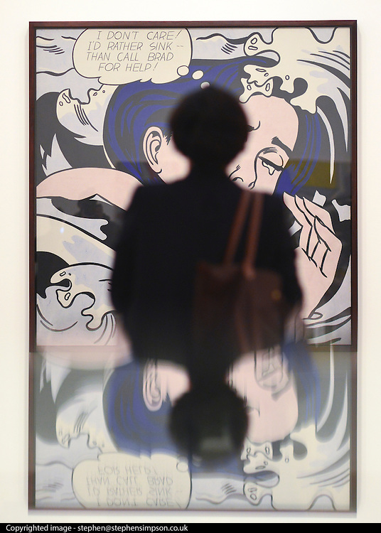 """© Licensed to London News Pictures. 18/02/2013. London, UK A woman stands stands in front of """"Drowning Girl""""  1963. Press view for Tate Modern's """"Lichtenstein: A Retrospective"""". It is the first major Lichtenstein retrospective for twenty years, bringing together 125 of the artists most definitive paintings. The exhibition is open to the public from 21 February -  27 May 2013.  Photo credit : Stephen Simpson/LNP"""
