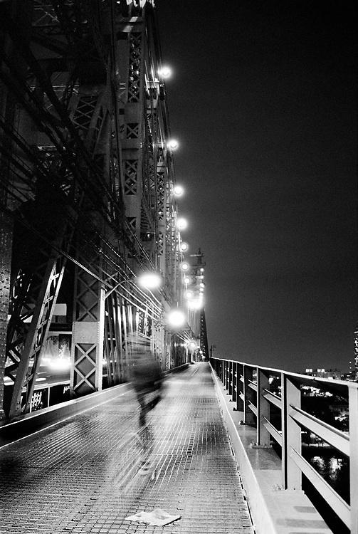 Bike rider crossing the 59th Street Bridge in New York City.