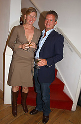 SOREN JESSEN and NATASHA ILLUM BERG at a private view of artist Adam Bricusse's paintings entitles 'The Mysteries Within' held at the Charing X Gallery, 121-125 Charing Cross Road, London WC2 on 12th September 2006.<br />