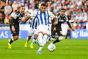 Karlan Grant of Huddersfield Town (16) scores a goal to make the score 1-2 with a penalty during the EFL Sky Bet Championship match between Huddersfield Town and Derby County at the John Smiths Stadium, Huddersfield, England on 5 August 2019.