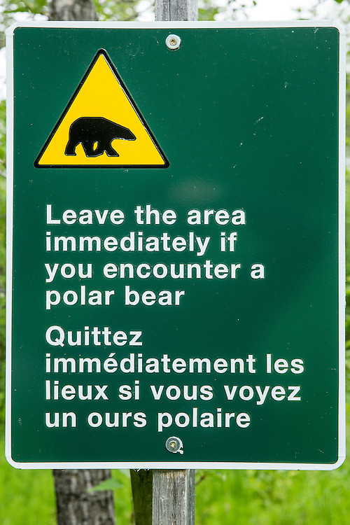 Canada, Manitoba, York Factory National Historic Site, Polar bear warning sign in boreal forest above Hayes River along Hudson Bay