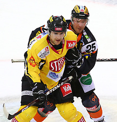 08.01.2012, Albert Schultz Halle, Wien, AUT, EBEL, UPC Vienna Capitals vs Moser Medical Graz 99ers, im Bild Jonathan Ferland, (UPC Vienna Capitals, #24) und Yvan Busque, (Moser Medical Graz 99ers, #25) // during the icehockey match of EBEL between UPC Vienna Capitals (AUT) and Moser Medical Graz 99ers (AUT) at Albert Schultz Halle, Vienna, Austria on 08/01/2012,  EXPA Pictures © 2012, PhotoCredit: EXPA/ T. Haumer