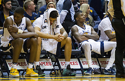 Jan 18, 2017; Morgantown, WV, USA; West Virginia Mountaineers players react on the bench after losing to the Oklahoma Sooners at WVU Coliseum. Mandatory Credit: Ben Queen-USA TODAY Sports