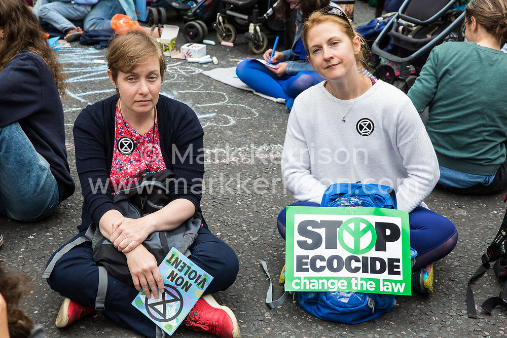 London, UK. 15 July, 2019. Climate activists from Extinction Rebellion block the road outside the Royal Courts of Justice at the beginning of the group's 'summer uprising', a series of events intended to apply pressure on local and central government to address the climate and biodiversity crisis. Credit: Mark Kerrison/Alamy Live News