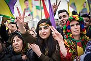 Frankfurt | 18 March 2017<br /> <br /> Am Samstag (18.02.2017) feierten &uuml;ber 30000 Kurden im Rahmen einer Demonstration das kurdische Neujahrsfest Newroz, bei der Demo sprachen sie sich gegen eine Diktatur und f&uuml;r die Freilassung von PKK-F&uuml;hrer Abdullah &Ouml;calan aus.<br /> Hier: Die Kundgebung nach der Demo findet im Europaviertel statt, eine junge Frau hebt ihre Finger zum Victory-Zeichen.<br /> <br /> photo &copy; peter-juelich.com<br /> <br /> Nutzung honorarpflichtig!