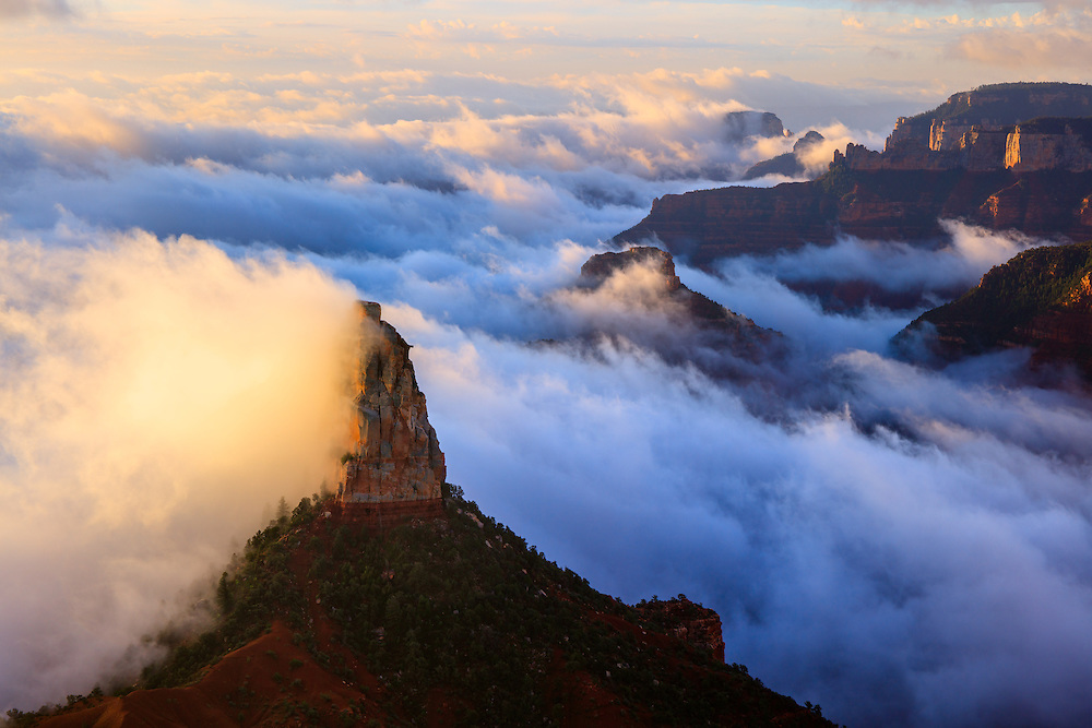 Mount Hayden rises above a layer of clouds. Viewed from Point Imperial on the North Rim of Grand Canyon National Park.