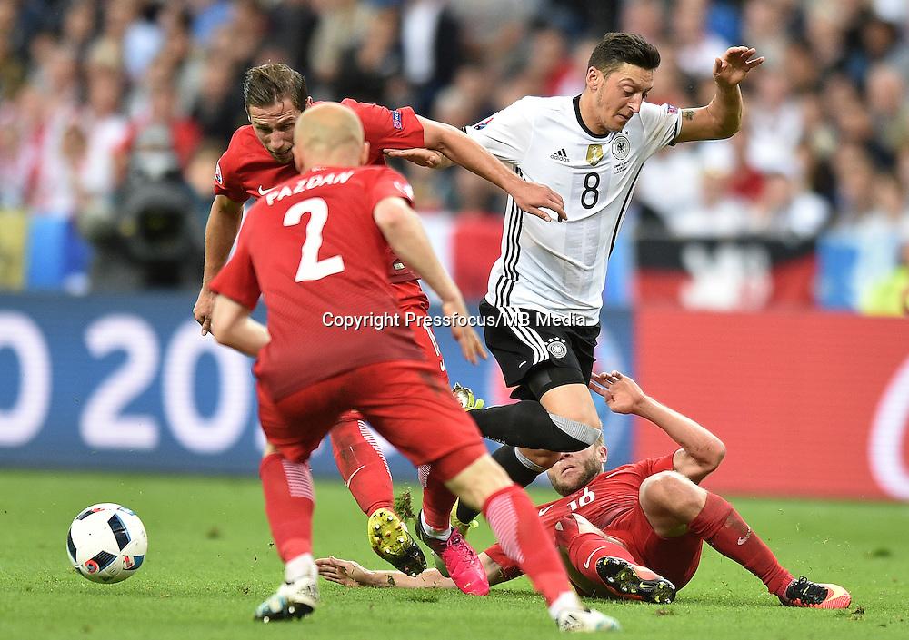 2016.06.16 Saint-Denis<br /> Pilka nozna Euro 2016<br /> mecz grupy C Polska - Niemcy<br /> N/z Mesut Ozil, Jakub Blaszczykowski<br /> Foto Lukasz Laskowski / PressFocus<br /> <br /> 2016.06.16 Saint-Denis<br /> Football UEFA Euro 2016 group C game between Poland and Germany<br /> Mesut Ozil, Jakub Blaszczykowski<br /> Credit: Lukasz Laskowski / PressFocus