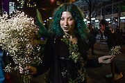 New York, NY - 31 October 2016. A woman costumed as a winged wood nymph carrying white flowers  in the Greenwich Village Halloween Parade.