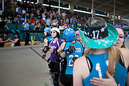 The San Diego Derby Dolls celebrate after winning the Battle on the Bank III tournament, held at the San Diego County Fair, June 27, 2010.