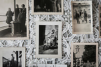 VERBANIA, ITALY - 18 APRIL 2017: Old pictures of Emma Morano, including one of her on a Vespa in the 1950's (center), are seen here in her small room in Verbania, Italy, on April 18th 2017.<br /> <br /> Emma Morano, born in 1899, was an Italian supercentenarian who, prior to her death at the age of 117 years and 137 days, was the world's oldest living person whose age had been verified, and the last living person to have been verified as being born in the 1800s. She died on April 15th 2017.