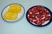 plates of Pineapple and strawberry fruit snacks