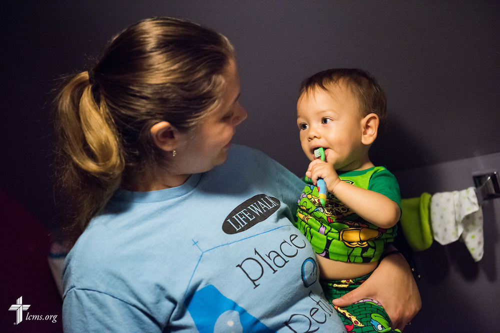 Resident and expectant mother Tiffany Busse helps her son Ezekiel Vela brush his teeth during bedtime at A Place of Refuge on Tuesday, Sept. 1, 2015, in Milwaukee, Wis. LCMS Communications/Erik M. Lunsford