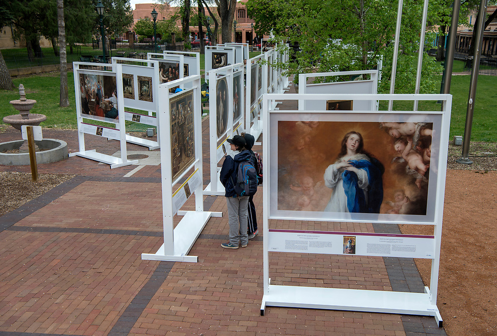 em051017e/jnorth/Dozens of people including an art school from Boulder Co., walk through The PRADO in Santa Fe exhibit in Cathedral Park Santa Fe, Wednesday May 10, 2017.  (Eddie Moore/Albuquerque Journal