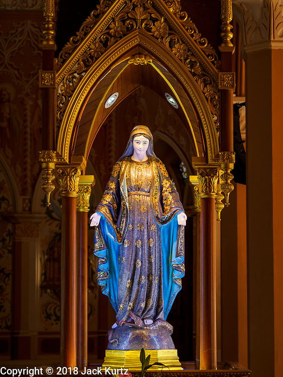 23 DECEMBER 2018 - CHANTABURI, THAILAND:  A jewel encrusted statue of the Virgin Mary in the Cathedral of the Immaculate Conception in Chantaburi. It is the largest Catholic church in Thailand and was founded more than 300 years ago by Vietnamese Catholics who emigrated to Thailand. The current cathedral building was sited and construction started while Chantaburi was occupied by French forces that had occupied neighboring Cambodia. The cathedral was finished after the French were expelled from Thailand. Chantaburi is the capital city of Chantaburi province on the Chantaburi River. Because of its relatively well preserved tradition architecture and internationally famous gem market, Chantaburi is a popular weekend destination for Thai tourists.   PHOTO BY JACK KURTZ