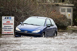 © Licensed to London News Pictures. 06/03/2019. Leeds UK. An abandoned car sits in flood water this morning in Leeds. Heavy rain last night has caused flooding in Leeds this morning leaving cars abandoned in flood water on Knowsthorpe Lane in the Cross Green area of the city. Photo credit: Andrew McCaren/LNP
