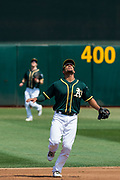 Oakland Athletics shortstop Marcus Semien (10) searches the sky for a pop fly against the Los Angeles Angels at Oakland Coliseum in Oakland, California, on September 6, 2017. (Stan Olszewski/Special to S.F. Examiner)