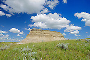 Clouds and butte (badlands) in East Block, Grasslands National Park, Saskatchewan, Canada