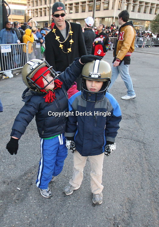 Feb 09, 2010; New Orleans, LA, USA; New Orleans Saints fans celebrate during the Super Bowl celebration parade for the New Orleans Saints 31-17 victory over the Indianapolis Colts in Super Bowl XLIV as the parade passed through the downtown streets of New Orleans, Louisiana.  Mandatory Credit: Derick E. Hingle-US-PRESSWIRE.