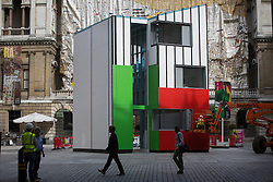 © licensed to London News Pictures. London, UK 13/08/2013. As part of the Royal Academy's current exhibition Richard Rogers RA: Inside Out, a three and a half storey building called Homeshell has been erected in the Courtyard in front of Burlington House in central London. The Homeshell is a low-cost house that uses the pioneering technology with a flexible, quick and highly energy efficient building system which can be adapted to suit particularly highly urban or small sites. Photo credit: Tolga Akmen/LNP