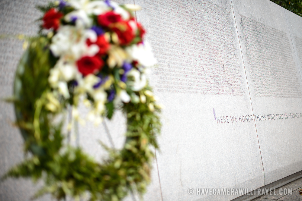 A wreath lies in front of a long list of names of Japanese Americans who died fighting in World War II at the Memorial to Japanese-American Patriotism in World War II near the US Capitol in Washington DC. The memorial was designed by Davis Buckley and Nina Akamu and commemorates those held in Japanese American internment camps during World War II.
