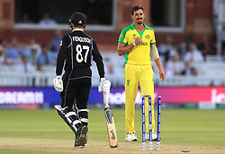 New Zealand's Lockie Ferguson is bowled out by Australia's Mitchell Starc (right) during the ICC Cricket World Cup group stage match at Lord's, London.
