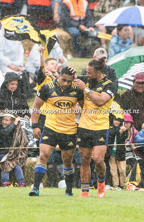 Hurricane's Ngani Laumape is congratulated on his match winning try. Hurricanes v Crusaders, Super rugby preseason match, Farmlands Grass Roots Rugby, Border Rugby Club, Waverley, New Zealand. Friday,  17 February, 2017. Copyright photo: John Cowpland / www.photosport.nz