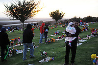 Families walk to the graves of their loved ones at Queen of Heaven Cemetery. In a touching final celebration of All Soul's Day on Saturday night, hundreds of congregants came to the hilltop in Salinas to attend mass, offer their prayers, and as dusk fell, participate in a candlelight procession.  Friends and family members sat by the graves of loved ones, many of which were decorated with traditional Day of the Dead marigolds, photographs of the departed, and things that were their favorites in life.
