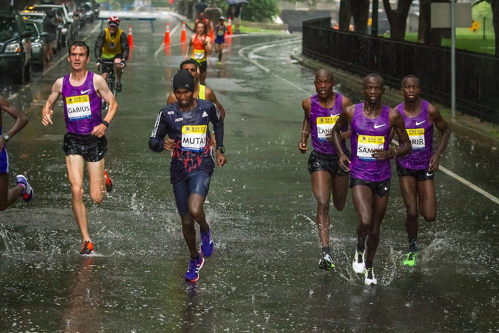 BAA 10K: lead pack runs through rain-soaked street, Geoffrey Mutai