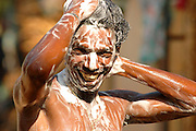 In a lather! Man having a soapy bath - South India.