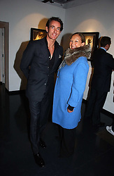 TIM JEFFERIES and MIMI O'CONNELL at an exhibition of late photographer Horst entitled 'Horst Platinum' at the Hamiltons Gallery, 13 Carlos Place, London on 28th November 2006.<br />