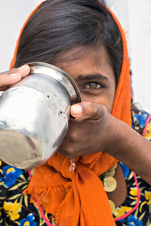 Close-up of a girl from Rajasthan drinking water.
