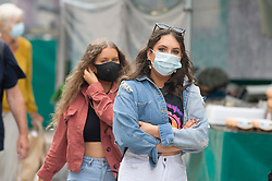 ©Licensed to London News Pictures 24/07/2020     <br /> Bromley, UK. Shoppers at a busy Bromley High Street in South East London today wearing face masks. A face mask or covering becomes compulsory from today when entering a petrol station, shop, train station, bank, post office or a shopping centre. The new rule is to help in the fight against coronavirus. Photo credit: Grant Falvey/LNP