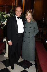 CHRISTOPHER CAZENOVE and EMILIA FOX at a carol concert in aid of the Institute of Cancer Research at the Royal Hospital Chapel, Chelsea on 2nd December 2004.<br />