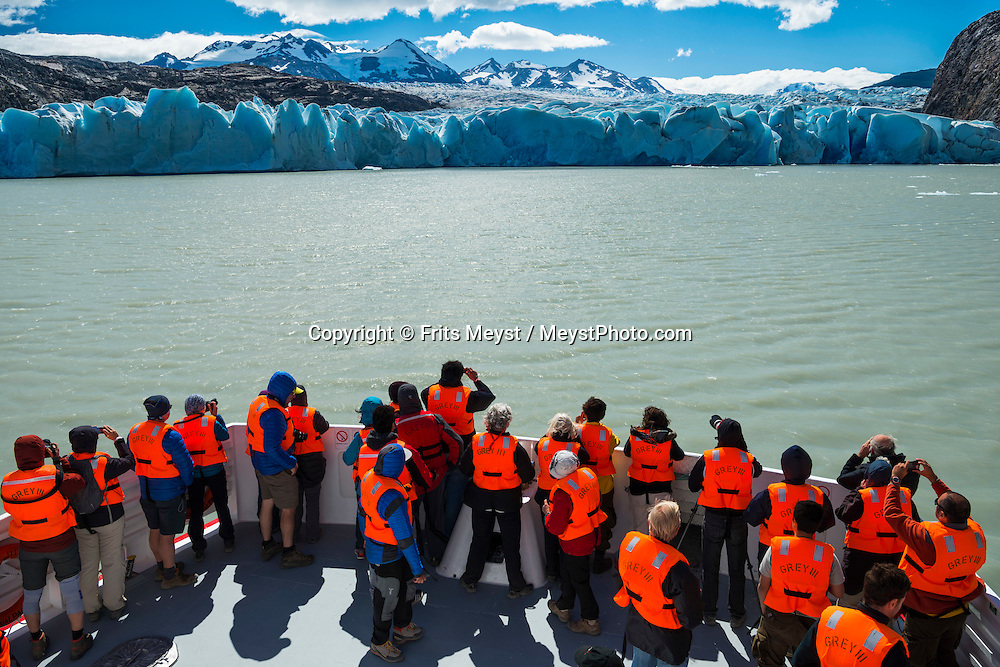 Patagonia, Chile, February 2016. A boat tour is the best way to see the Grey Glacier for non hikers. The most highly trekked route in Torres del Paine National Park is called the 'W'. This trail system can be done in a variety of ways, from more rugged camping style treks, to full room and board in refugios. The W Circuit is named after its trail system that navigates up and down out of the mountain valleys. Torres del Paine is a UNESCO World Biosphere Reserve and encompasses mountains, glaciers, lakes, and rivers in southern Chilean Patagonia. The Cordillera del Paine is the centerpiece of the park. It lies in a transition area between the Magellanic subpolar forests and the Patagonian Steppes. A 4x4 camper is one of the best vehicles to explore the wild interior of Southern Patagonia. Photo by Frits Meyst / MeystPhoto.com